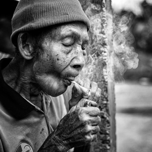 Sasak old man smoking